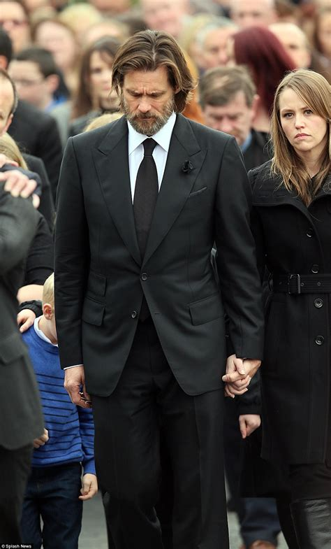 Jim Carrey carries Cathriona White's coffin at funeral as